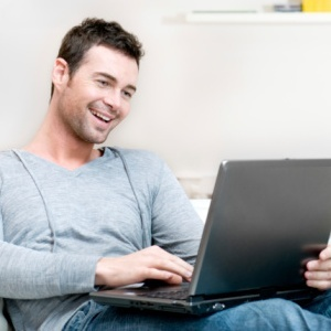 man with laptop on lap